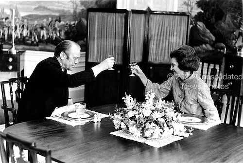 United States President Gerald R. Ford and his wife, first lady Betty Ford, exchange toasts at a luncheon as they celebrated their 26th wedding anniversary in the Residence of the White House in Washington, D.C. on October 15, 1974.  Mrs. Ford was released from Bethesda National Naval Medical Center where she underwent surgery for breast cancer.<br /> Mandatory Credit: David Hume Kennerly / White House via CNP
