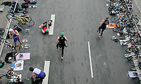 01 JUL 2007 - COPENHAGEN, DEN - Competitors race through transition - European Age Group Triathlon Championships. (PHOTO (C) NIGEL FARROW)