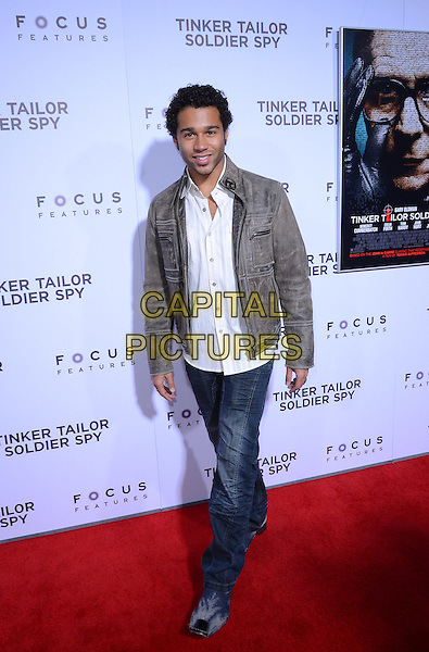 Corbin Bleu.The premiere of Focus Features' 'Tinker, Tailor, Soldier, Spy' held at Arclight Cinema's Cinerama Dome, Los Angeles, California, USA..December 6th, 2011.full length white shirt grey gray leather jacket jeans denim.CAP/ADM/TW.©Tonya Wise/AdMedia/Capital Pictures.