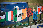 A supporter of Irish club Bohemians tying flags behind the goal at Park Hall Stadium, Oswestry before their team's Champions League 2nd qualifying round 2nd leg game away to The New Saints. Despite leading 1-0 from the first leg, the Dublin club went out following their 4-0 defeat by the Welsh champions. The match was the first-ever Champions League match in the UK played on an artificial pitch and was staged at the Welsh Premier League's ground which was located over the border in England.