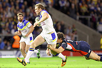 PICTURE BY ALEX WHITEHEAD/SWPIX.COM - Rugby League - Super League Play-Off - Warrington Wolves vs St Helens - The Halliwell Jones Stadium, Warrington, England - 15/09/12 - Warrington's Joel Monaghan is tackled by St Helens' Paul Wellens.