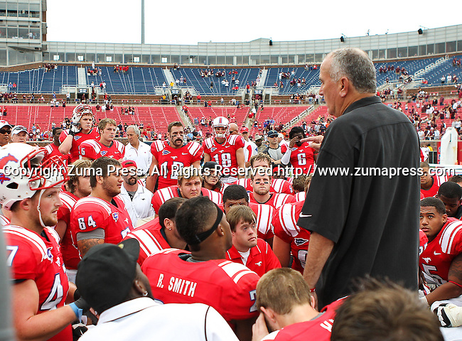 Southern Methodist Mustangs head coach, June Jones, talks to his team after the game between the Southern Methodist Mustangs and the Texas A&M Aggies at the Gerald J. Ford Stadium in Dallas, Texas. Texas A & M defeats SMU 48 to 3..
