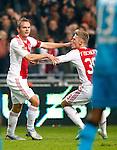 Nederland, Amsterdam, 1 december 2012.Seizoen 2012-2013.Eredivisie.Ajax-PSV .Siem de Jong (l.) van Ajax juicht nadat hij 1-0 heeft gescoord. Rechts Viktor Fischer van Ajax.