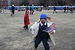 A young boy spins around with an American flag on the Washington Mall a day ahead of Barack Obama's historic inauguration as the 44th U.S. President in Washington DC on January 19, 2009.