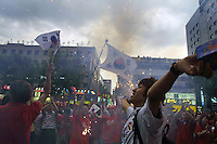 Korean national team supporters celebrate in the Gangnam neighborhood of Seoul, South Korea on June 22nd, 2002 after South Korea defeated Spain in a World Cup quarterfinal match on penalty kicks 5-3 .