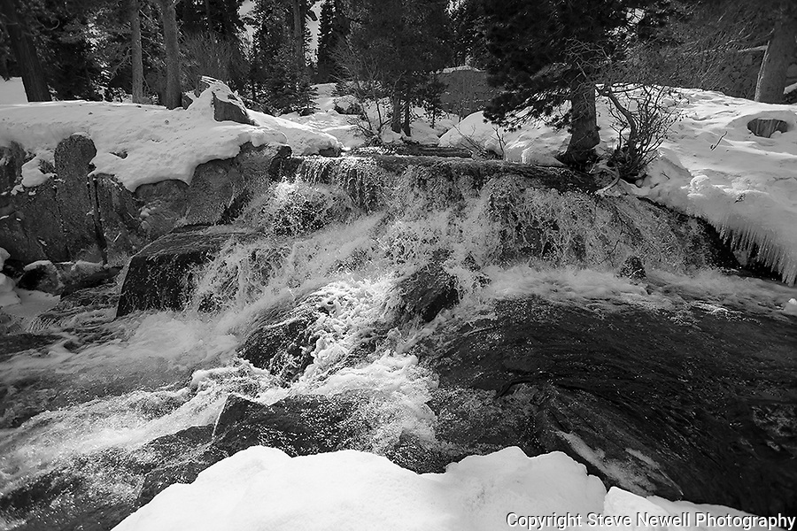 """""""The River"""" Black and White.  Eagle Falls waterfall at Emerald Bay, Lake Tahoe, CA.  I hiked out to Lower Eagle Falls above Emerald Bay during the Winter of 2013. The road was closed due to avalanche danger so I had the whole area to myself for the entire day.  Emerald Bay may be the most visited and photographed area in all of Lake Tahoe but on a few days you can enjoy the beauty in solitude. I shot both stills and HD 1080 video of the waterfall and Emerald Bay."""