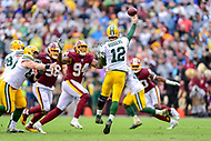 Landover, MD - September 23, 2018: Green Bay Packers quarterback Aaron Rodgers (12) throws a pass over Washington Redskins linebacker Preston Smith (94) during game between the Green Bay Packers and the Washington Redskins at FedEx Field in Landover, MD. The Redskins get the win 31-17 over the visiting Packers. (Photo by Phillip Peters/Media Images International)