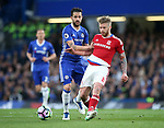 Chelsea's Cesc Fabregas tussles with Middlesbrough's Adam Clayton during the Premier League match at Stamford Bridge Stadium, London. Picture date: May 8th, 2017. Pic credit should read: David Klein/Sportimage