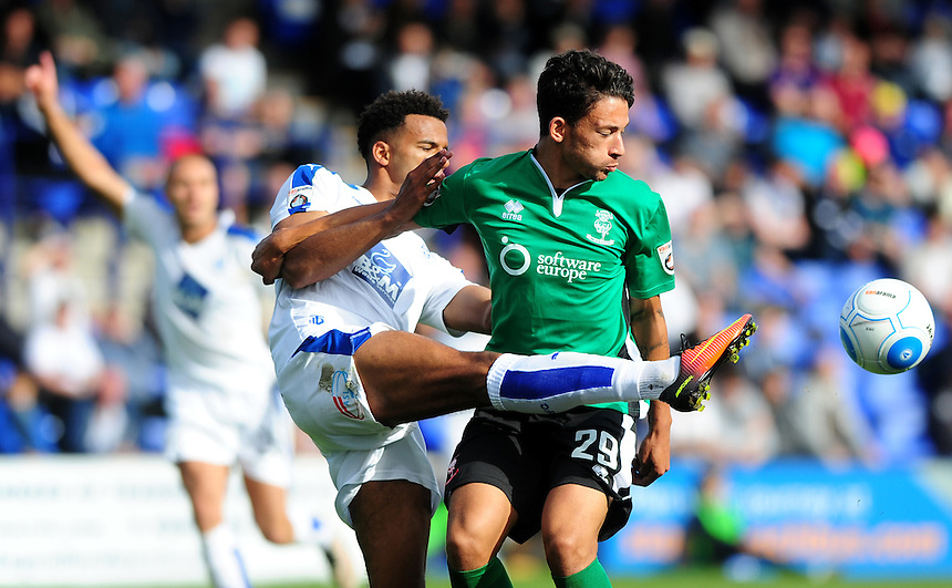 Lincoln City's Macauley Bonne vies for possession with Tranmere Rovers' Michael Ihiekwe<br /> <br /> Photographer Andrew Vaughan/CameraSport<br /> <br /> Vanarama National League - Tranmere Rovers v Lincoln City - Saturday 10th September 2016 - Prenton Park - Birkenhead<br /> <br /> World Copyright &copy; 2016 CameraSport. All rights reserved. 43 Linden Ave. Countesthorpe. Leicester. England. LE8 5PG - Tel: +44 (0) 116 277 4147 - admin@camerasport.com - www.camerasport.com