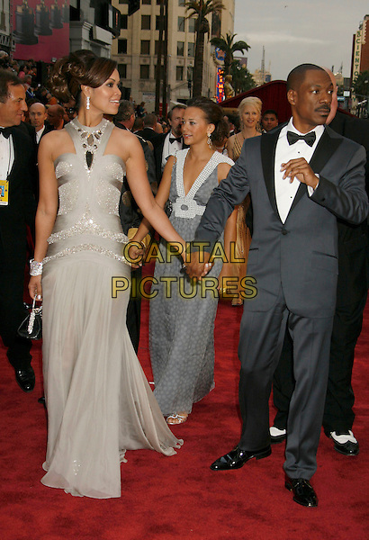 TRACEY EDMONDS & EDDIE MURPHY.The 79th Annual Academy Awards - Arrivals held at the Kodak Theatre. Hollywood, California, USA,.25 February 2007..oscars red carpet full length silver grey dress suit holding hands couple tracy.CAP/ADM/RE.©Russ Elliot/AdMedia/Capital Pictures.