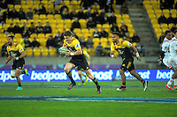 Beauden Barrett hares for the tryline after taking an intercept during the Super Rugby semifinal match between the Hurricanes and Chiefs at Westpac Stadium, Wellington, New Zealand on Saturday, 30 July 2016. Photo: Dave Lintott / lintottphoto.co.nz