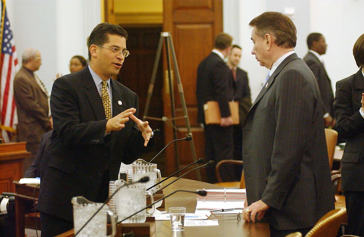 2/10/04.THOMPSON--Xavier Becerra, D-Calif., left, and Health and Human Services Secretary Tommy G. Thompson talk before the House Ways and Means hearing on the adminstration's fiscal 2005 budget proposal..CONGRESSIONAL QUARTERLY PHOTO BY SCOTT J. FERRELL