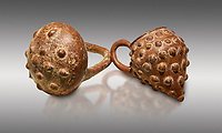 Bronze Age Anatolian terra cotta basket with handle & a beaker shaped as a bunch of grapes - 19th to 17th century BC - Kültepe Kanesh - Museum of Anatolian Civilisations, Ankara, Turkey. Against a grey background.