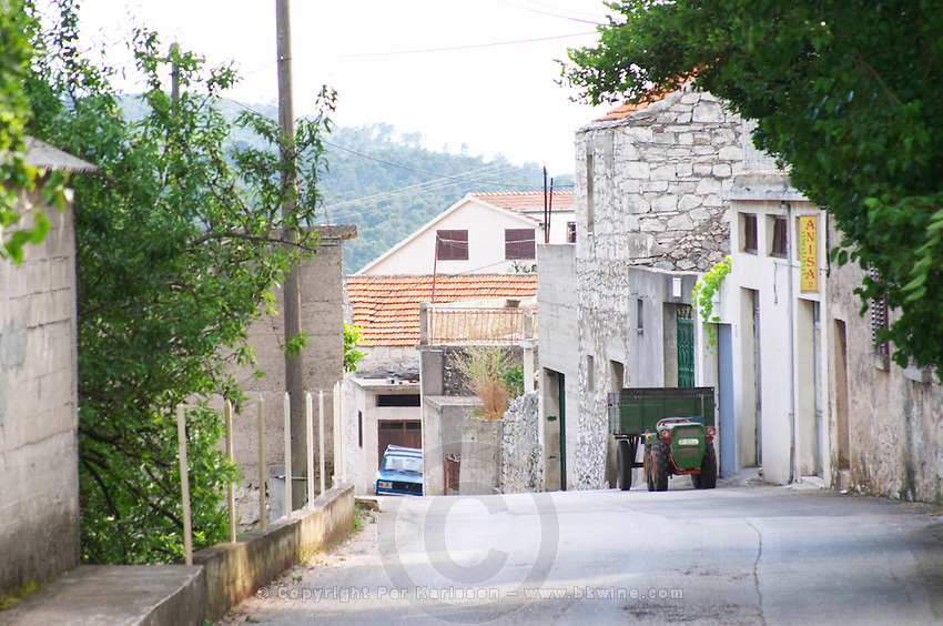 A view of the village street outside the winery. Toreta Vinarija Winery in Smokvica village on Korcula island. Vinarija Toreta Winery, Smokvica town. Peljesac peninsula. Dalmatian Coast, Croatia, Europe.