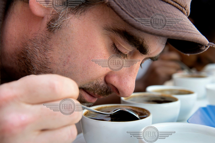 Geoff Watts, a buyer from Intelligentsia Coffee in the USA, smells a cup of freshly brewed coffee. /Felix Features