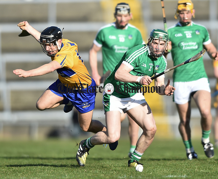 David Reidy of  Clare  in action against Sean Finn of  Limerick during their NHL quarter final at the Gaelic Grounds. Photograph by John Kelly.