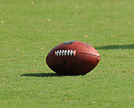 A football waits for to be used during New Orleans Saints training camp.