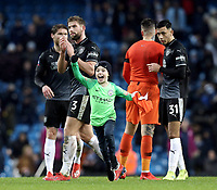 A young fan celebrates after Manchester City's Ederson gave him his shirt after he ran onto the pitch at the final whistle<br /> <br /> Photographer Rich Linley/CameraSport<br /> <br /> Emirates FA Cup Fourth Round - Manchester City v Burnley - Saturday 26th January 2019 - The Etihad - Manchester<br />  <br /> World Copyright © 2019 CameraSport. All rights reserved. 43 Linden Ave. Countesthorpe. Leicester. England. LE8 5PG - Tel: +44 (0) 116 277 4147 - admin@camerasport.com - www.camerasport.com