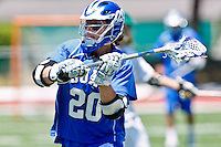 April 30, 2011:  Duke Blue Devils midfielder Charlie Payton (20) controls the ball during lacrosse action between the Duke Blue Devils and Jacksonville Dolphins at D. B. Milne Field in Jacksonville, Florida.  Duke defeated Jacksonville 10-6.