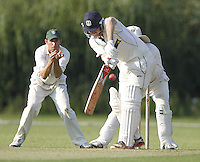 Tom Pettet bats for Harrow during the Middlesex County Cricket League Division Two game between Harrow St Mary's and Shepherds Bush at<br /> Harrow on Sat July 19, 2014