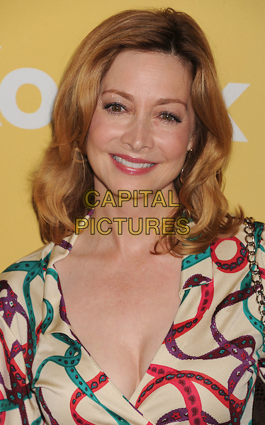 Sharon Lawrence.The 2012 Women In Film Crystal + Lucy Awards at The Beverly Hilton Hotel in Beverly Hills, California, USA..June 12th, 2012 .headshot portrait white cream red purple green print ribbon .CAP/ROT/TM.©Tony Michaels/Roth Stock/Capital Pictures