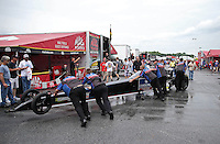 May 11, 2013; Commerce, GA, USA: Crew members push the car of NHRA top fuel dragster driver David Grubnic onto the hauler after losing during the Southern Nationals at Atlanta Dragway. Mandatory Credit: Mark J. Rebilas-