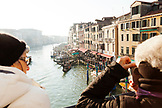 ITALY, Venice. Tourists taking pictures of the Grand Canal from the Rialto Bridge.