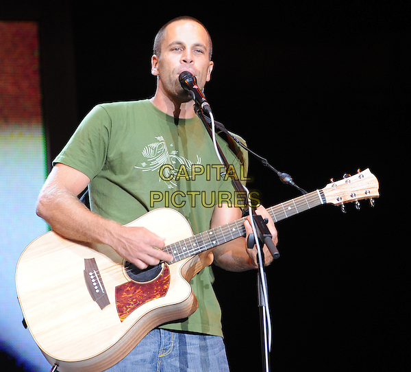 JACK JOHNSON.Performs at the Bonnaroo Music Festival, Manchester, Tennessee, USA,.14 June 2008..half length guitar green t-shirt gig concert on stage music .CAP/ADM/MOO.©Moose/Admedia/Capital Pictures