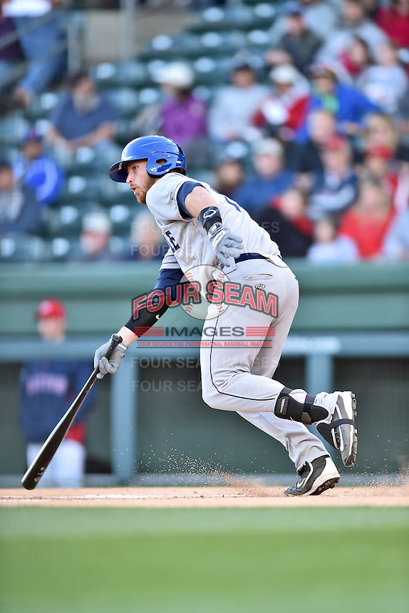 Asheville Tourists first baseman Brian Mundell (15) swings at a pitch during a game against the Greenville Drive at Fluor Field on April 7, 2016 in Greenville South Carolina. The Drive defeated the Tourists 4-3. (Tony Farlow/Four Seam Images)