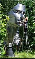 BNPS.co.uk (01202 558833)<br /> Pic: PhilYeomans/BNPS<br /> <br /> Eddie Powells daughter Sian cleans the monumental 'Paraiso' by Cuban artist Rafael san Juan, yours for £80,000 - if you have a garden big enough.<br /> <br /> The ultimate garden sale...<br /> <br /> A bronze bust of Sir Winston Churchill leads an epic £5m sale of 400 garden sculptures an art fanatic is putting under the hammer.<br /> <br /> Eddie Powell turned 10 acres of unused land in the Surrey countryside into one of the world's largest sculpture parks 15 years ago.<br /> <br /> He crammed it with over 800 eye-catching pieces of art, ranging from a 19 tonne dragon made from 152,000 horse shoes to a 12ft tall bronze polar bear.<br /> <br /> Mr Powell is now down-sizing the collection and is selling half of the items in the park.