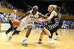 14 November 2013: Duke's Chelsea Gray (12) and USC Upstate's Maddie Herr (31). The Duke University Blue Devils played the University of South Carolina Upstate Spartans at Cameron Indoor Stadium in Durham, North Carolina in a 2013-14 NCAA Division I Women's Basketball game. Duke won the game 123-40.