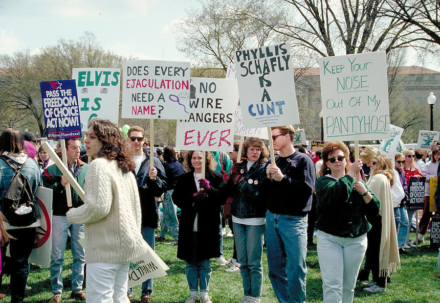 A signholders in a crowd scene at a Pro Choice March and Rally on the ellipse near the White House, in Washington, D.C.  abortion, protest, politics, women, rights, power, demonstrations, political activism, protesters, obscene signs, public obsce enity.