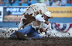 Baylor Roche competes in the steer wrestling event at the Reno Rodeo in Reno, Nev., on Thursday, June 27, 2013.<br /> Photo by Cathleen Allison