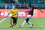 Borussia Dortmund Defender Lukasz Piszczek (L) fights for the ball with AC Milan Forward MBaye Niang (R) during the International Champions Cup 2017 match between AC Milan vs Borussia Dortmund at University Town Sports Centre Stadium on July 18, 2017 in Guangzhou, China. Photo by Marcio Rodrigo Machado / Power Sport Images
