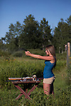 Young woman shooting a Ruger Bearcat .22 revolver