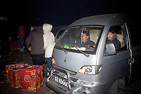 Fireworks sellers (in van) leave the White Horse Sculpture Park before police confiscate their fireworks in Nanjing, Jiangsu, China, on the night of Lunar New Year celebrations. Lunar New Year is also known as Chinese New Year.  2009 is the Year of the Ox, the Year of the Cow, or the Year of the Bull, according to the Chinese zodiac.  Niu is the Mandarin word for ox/cow/bull.