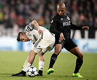 Juventus' Paulo Dybala, left, is challenged by Porto's Yacine Brahimi during the Champions League round of 16 soccer match against Porto at Turin's Juventus Stadium, 14 March 2017. Juventus won 1-0 (3-0 on aggregate) to reach the quarter finals.<br /> UPDATE IMAGES PRESS/Isabella Bonotto