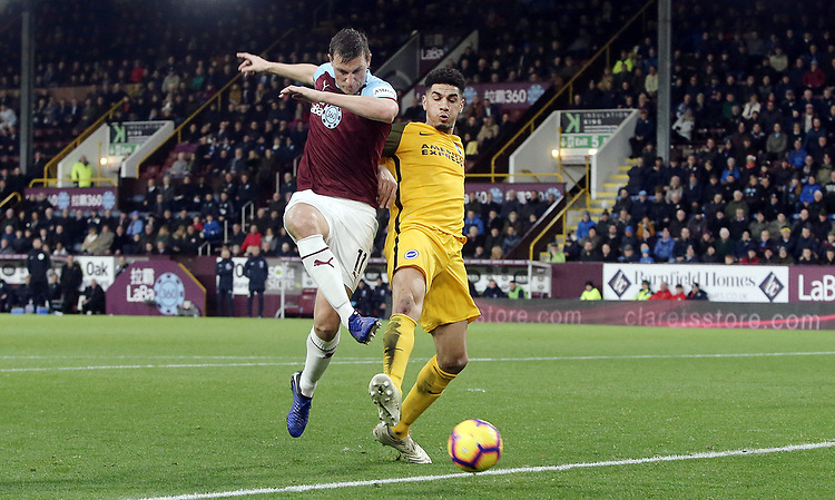 Burnley's Chris Wood scuffs a close range shot under pressure from Brighton & Hove Albion's Leon Balogun<br /> <br /> Photographer Rich Linley/CameraSport<br /> <br /> The Premier League - Burnley v Brighton and Hove Albion - Saturday 8th December 2018 - Turf Moor - Burnley<br /> <br /> World Copyright © 2018 CameraSport. All rights reserved. 43 Linden Ave. Countesthorpe. Leicester. England. LE8 5PG - Tel: +44 (0) 116 277 4147 - admin@camerasport.com - www.camerasport.com