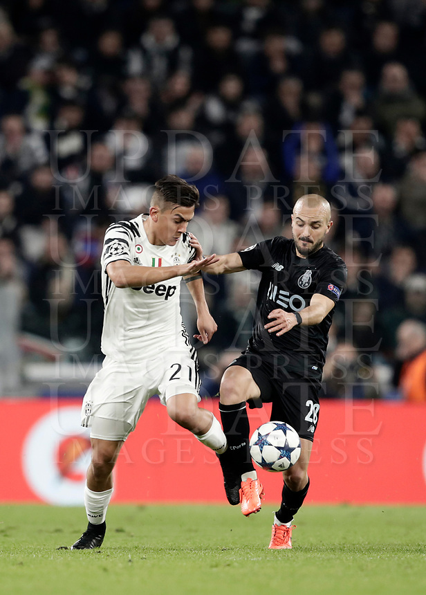 Porto's Andre' Andre', right, is challenged by Juventus' Paulo Dybala during the Champions League round of 16 soccer match against Porto at Turin's Juventus Stadium, 14 March 2017. Juventus won 1-0 (3-0 on aggregate) to reach the quarter finals.<br /> UPDATE IMAGES PRESS/Isabella Bonotto