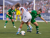 PASADENA, CA - AUGUST 4: Tobin Heath #17 and Harriet Scott #3 fight for the ball during a game between Ireland and USWNT at Rose Bowl on August 3, 2019 in Pasadena, California.