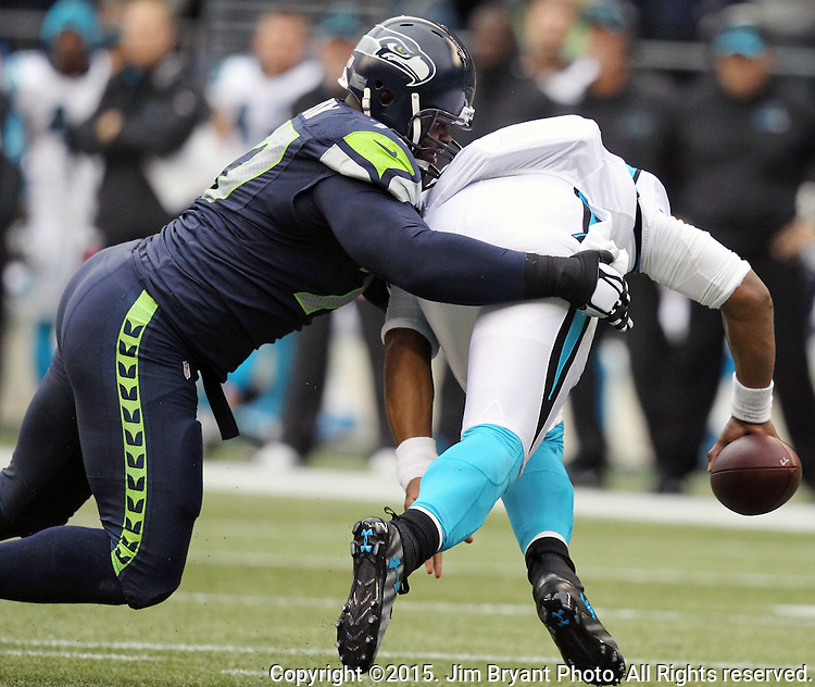 Carolina Panthers  quarterback Kam Newton (1) is sacked by Seattle Seahawks defensive tackle Ahtyba Rubin (77) at CenturyLink Field in Seattle on October 18, 2015. The Panthers came from behind with 32 seconds remaining in the 4th Quarter to beat the Seahawks 27-23.  ©2015 Jim Bryant Photography. All Rights Reserved.