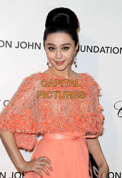 Fan Bingbing.21st Annual Elton John Academy Awards Viewing Party held at West Hollywood Park, West Hollywood, California, USA..February 24th, 2013.oscars half length black clutch bag beads beaded wrap shawl dress peach pink sheer dress .CAP/ADM/KB.©Kevan Brooks/AdMedia/Capital Pictures.