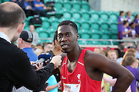 Tuesday 15th July 2014<br /> Pictured: Christian Malcolm<br /> RE: Welsh sprinter Christian Malcolm, being interviewed by the media after competing in the 4x100m relay at the Welsh Athletics International in the Cardiff International Sports Stadium, South Wales, UK. His last race on home soil.