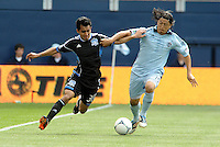 Roger Espinoza (15) Kansas City midfielder holds off Rafael Baca (30) San Jose... Sporting Kansas City defetaed San Jose Earthquakes 2-1 at LIVESTRONG Sporting Park, Kansas City, Kansas.