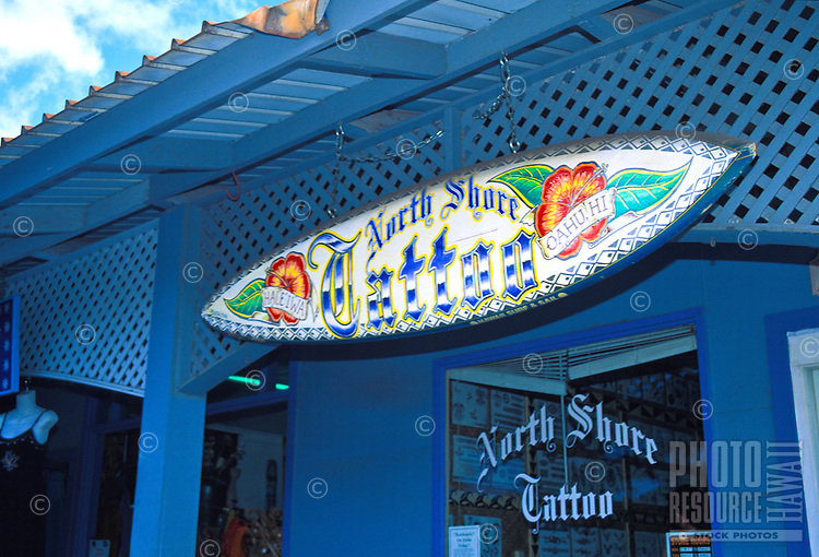 The body art of Tatooing has become popular. This studio in the town of Haleiwa on oahu's north shore offers a variety of tatoo styles including the Hawaiian Tribal Warrior Tatoo