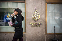 The AlJazeera America logo on the exterior of the New Yorker hotel in New York where the cable news channel's US headquarters and studios are located, seen on Friday, October 25, 2013. The cable news channel started broadcasting in English in the United States in August. (© Richard B. Levine)