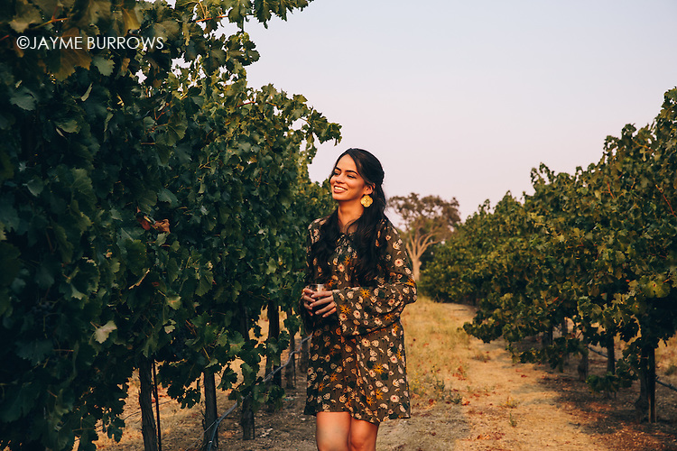 Portrait of an attractive 30 something woman in wine country.