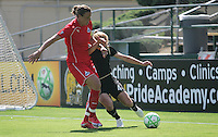 Abby Wambach (left) and Rachel Buehler (right) battle for the ball. Washington Freedom defeated FC Gold Pride 4-3 at Buck Shaw Stadium in Santa Clara, California on April 26, 2009.
