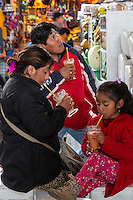 Peru, Cusco, San Pedro Market.  Family Drinking Fruit Juice Smoothies.