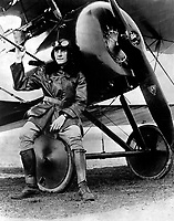 Lt. Earl Carroll, prominent composer, is now a full-fledged aviator in the U.S. Service.  He is shown beside his fast scout machine, Ca.  1918. IFS. (War Dept.)<br />